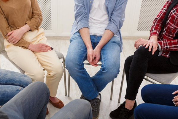 People sitting around in a circle sharing thoughts