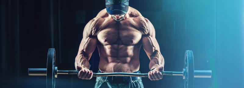 Man with muscles flexed lifting a barbell.