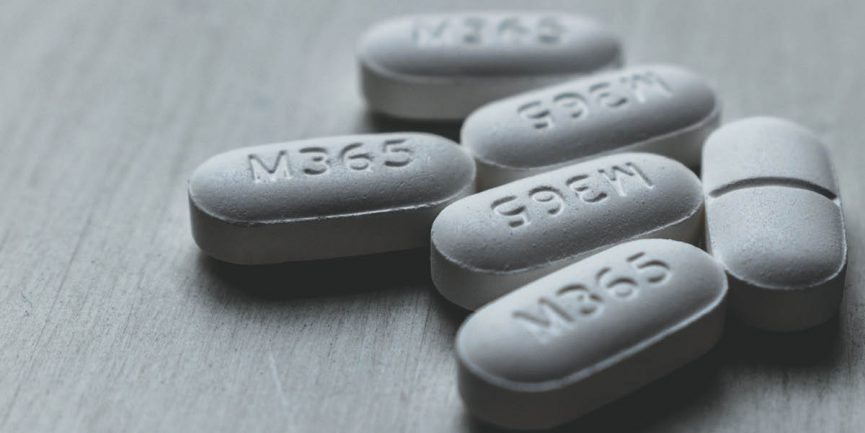 Norco pills on a table due to a person struggling with addiction