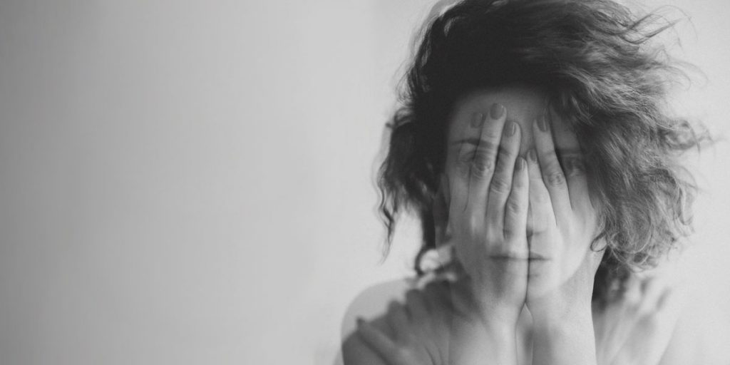 Woman with an anxiety disorder and alcohol addiction experiences negative effects