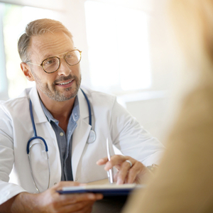 doctor with chart supporting patient through medical drug detox