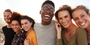 group of friends smiling, enjoying life in recovery